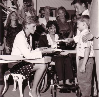 Princess Diana talking to young boy