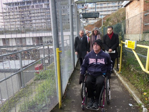 Joe Gilbert in his wheelchair demonstrating the accessible route