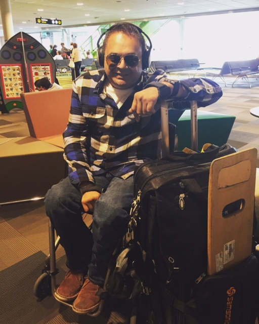 Indeep in his wheelchair at the airport