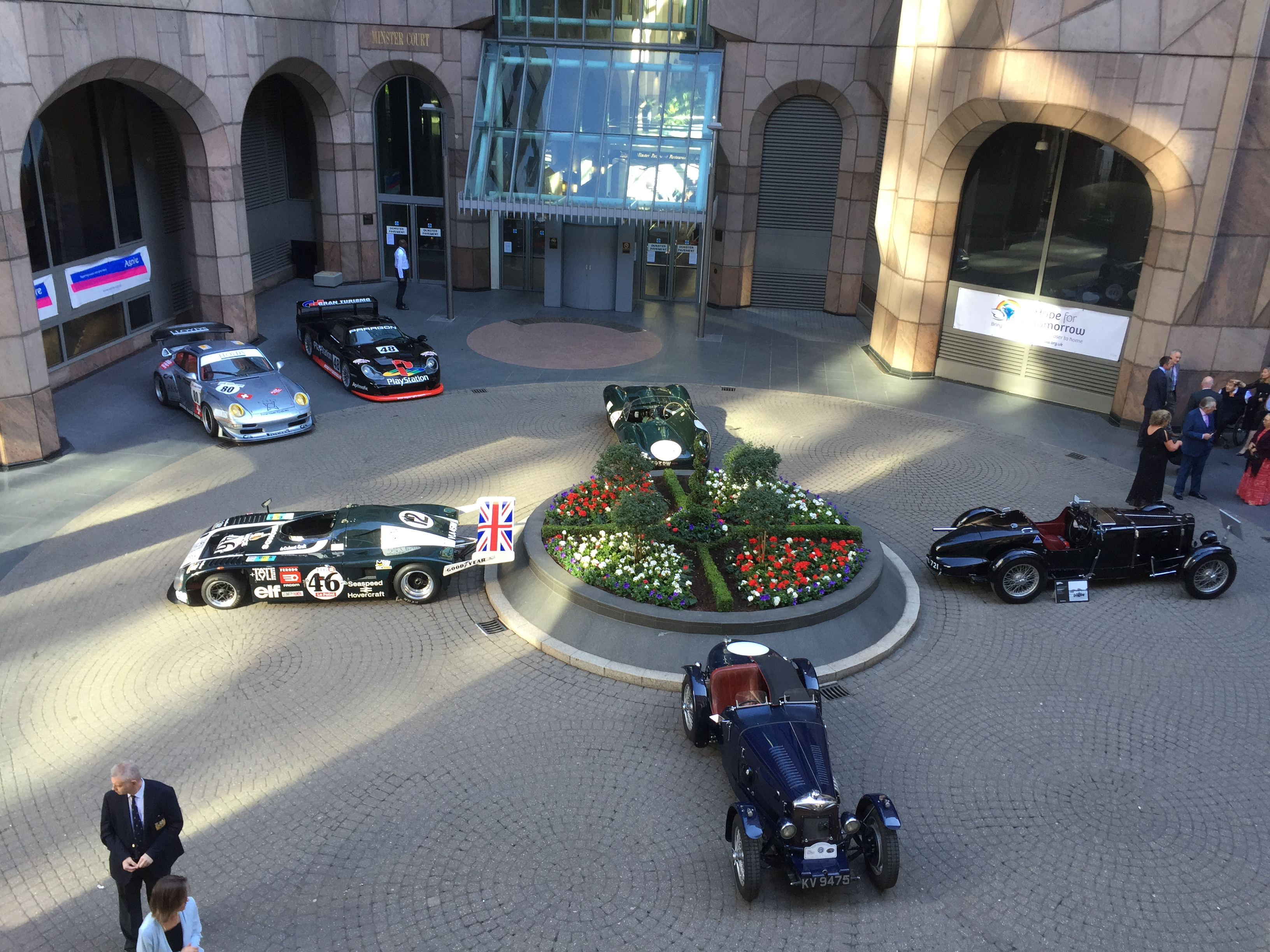 Le Mans cars in the courtyard