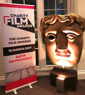 Charity Film Award sign and large BAFTA mask
