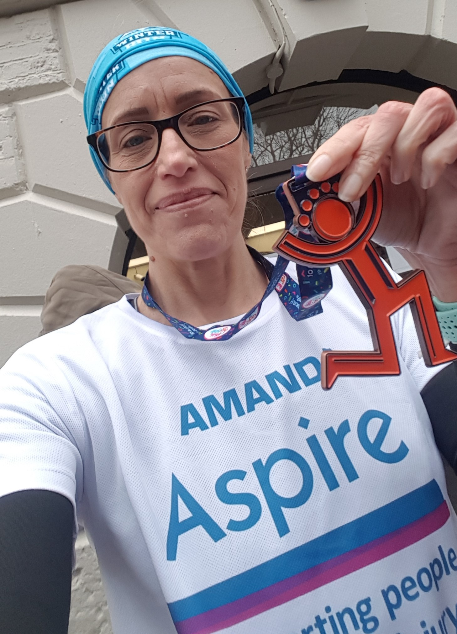 Amanda in Aspire t-shirt with medal