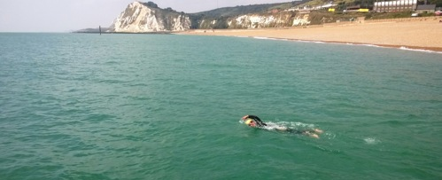 Swimmer with white cliffs of Dover