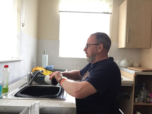 Paul washing up in the Aspire house