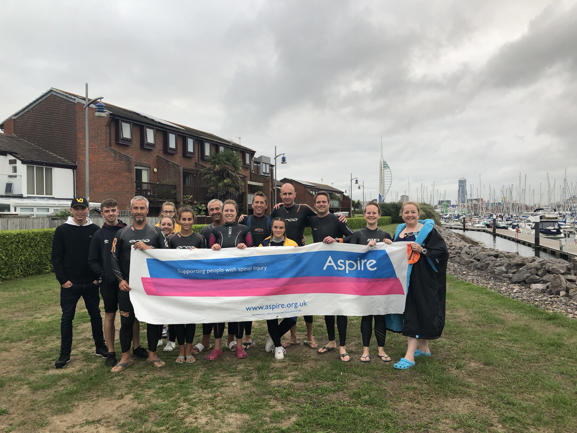 The Solent swimmers holding up an Aspire banner before the swim