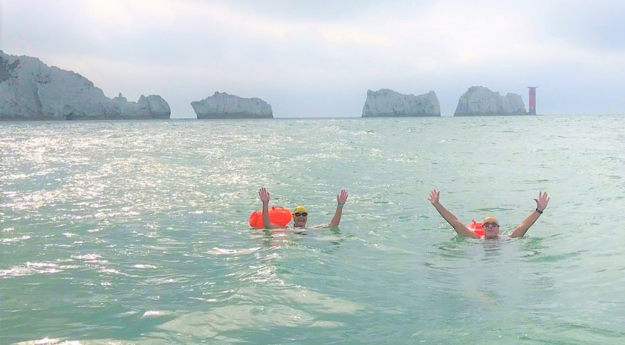 Swimmers in front of The Needles