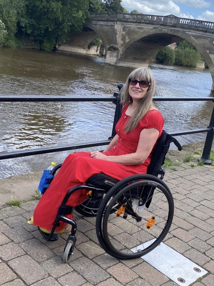 MIranda in her wheelchair by a river