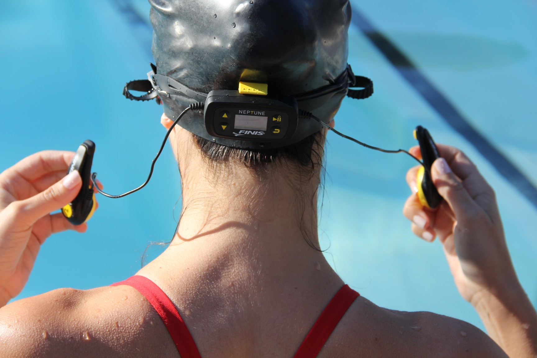 Swimmer putting on a waterproof headset