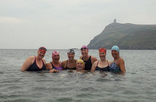 Relay channel swim team in the sea