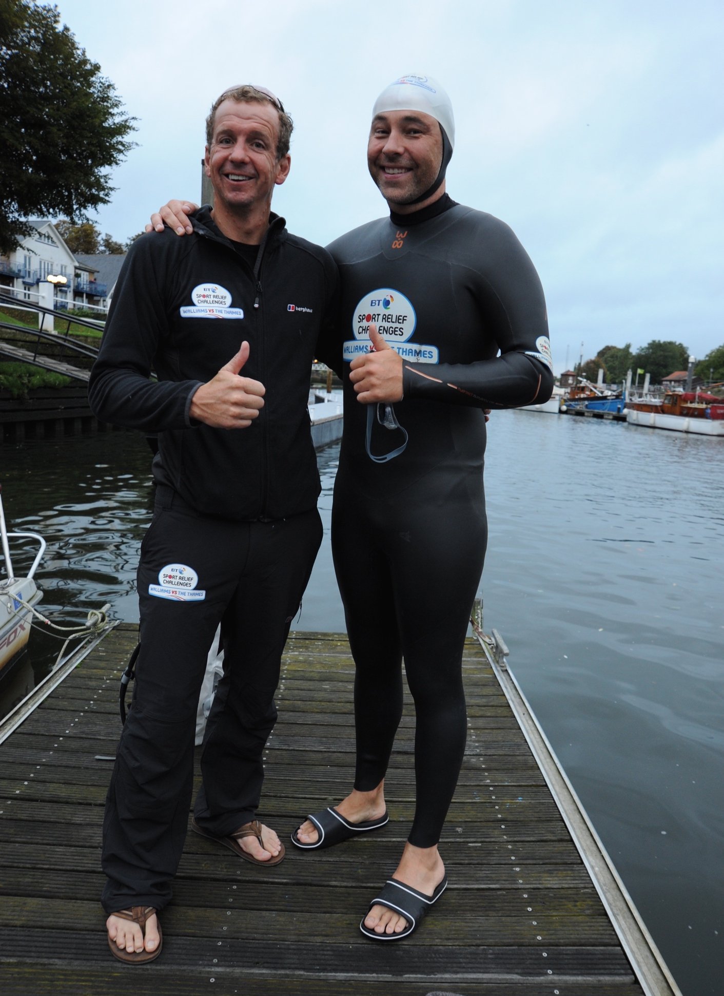 Greg Whyte and David Walliams standing on a jetty