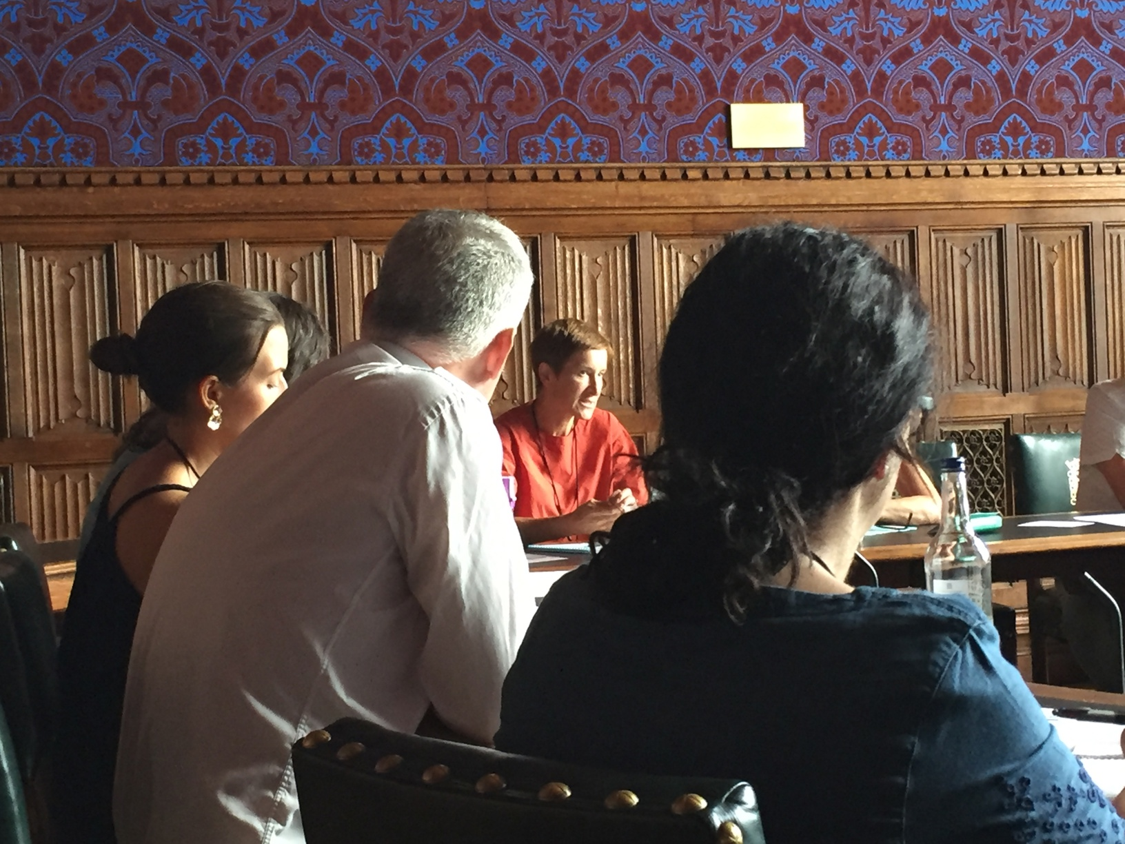 Participants in discussion at the round table event