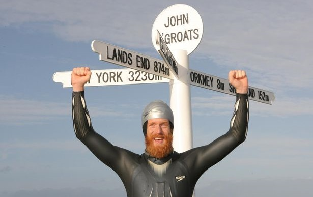 Sean Conway finishin ghis swim at John O