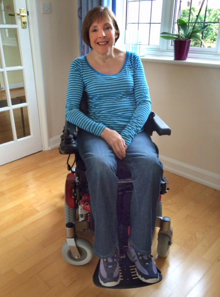 Claire in her new powered wheelchair