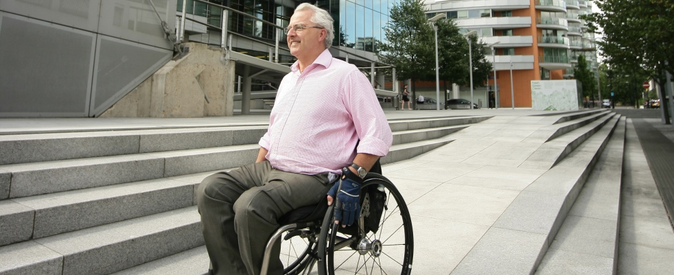 Man in wheelchair outside office building