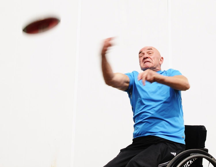 Man in wheelchair throwing the discus