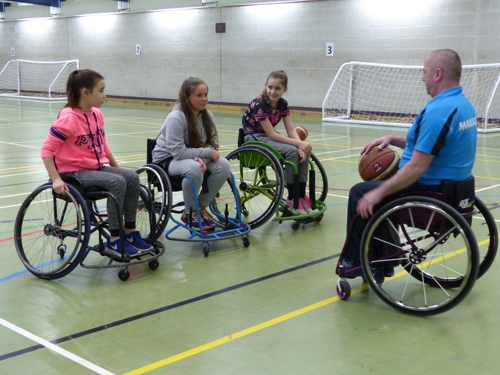 Joe Gilbert teaching wheelchair skills