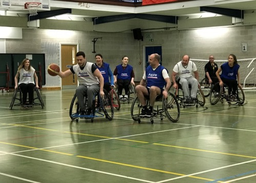 Clyde & Co playing wheelchair basketball