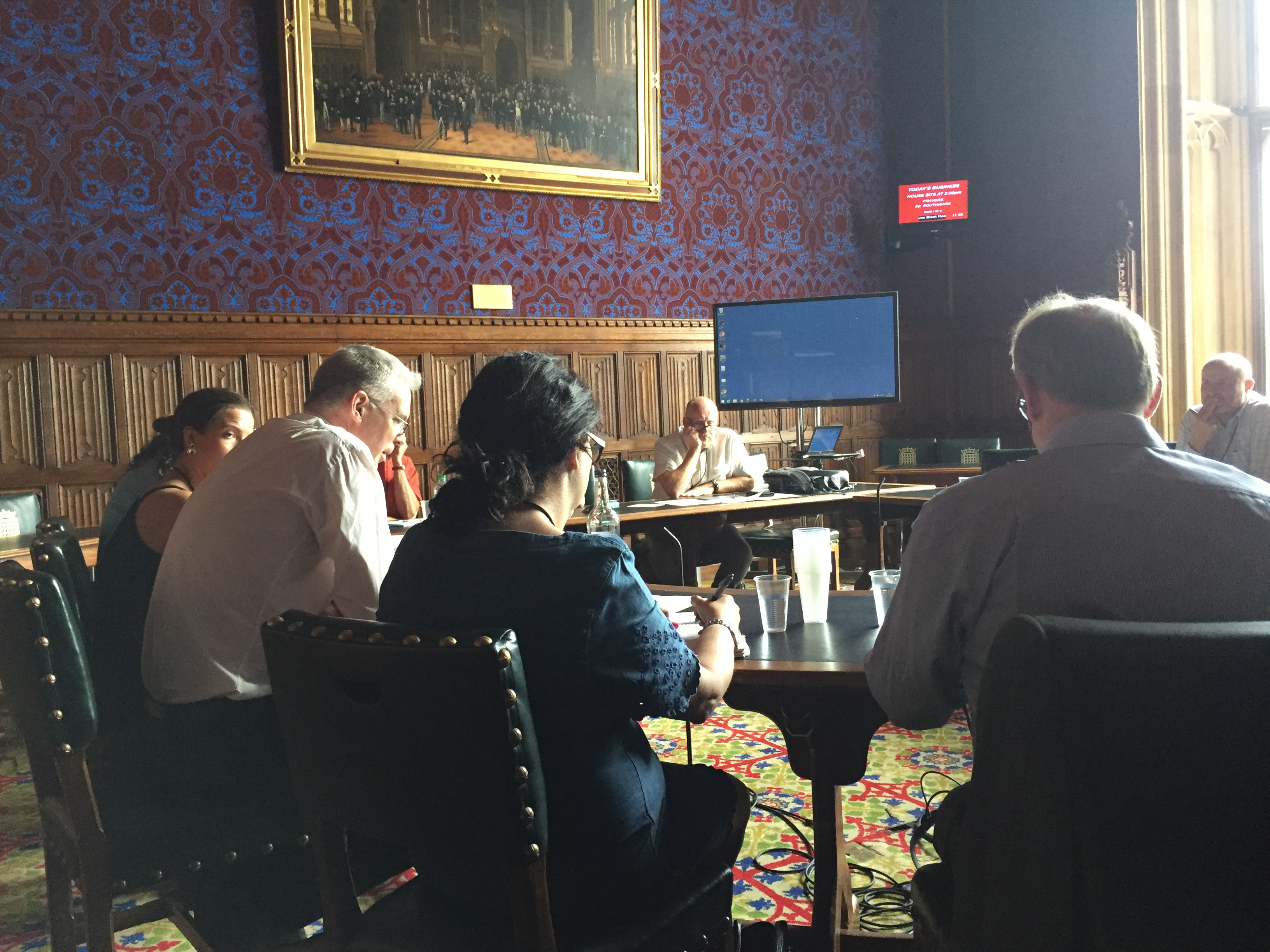 Participants in discussion at the parliamentary round table