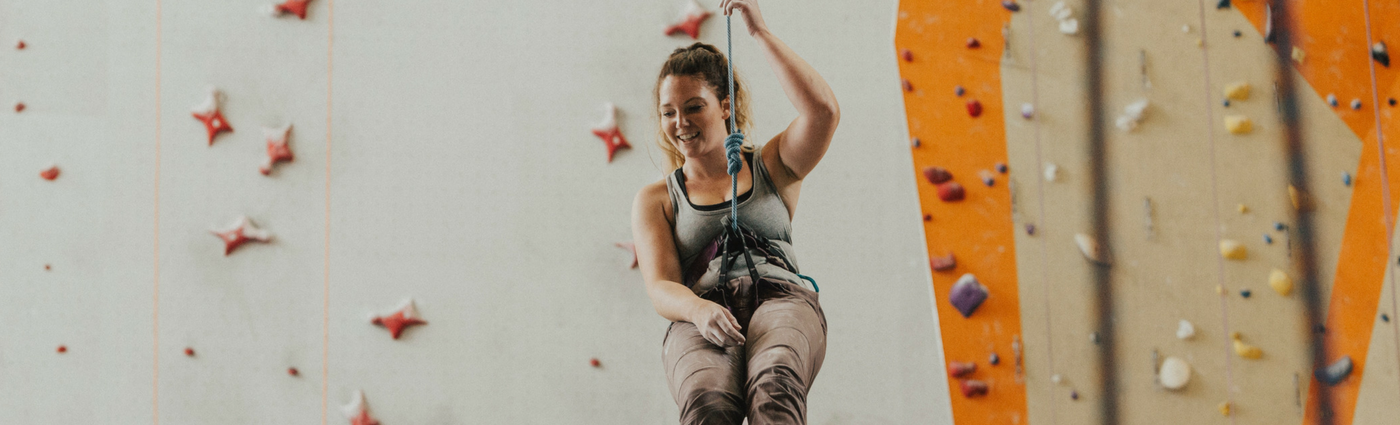 Girl trying rock climbing