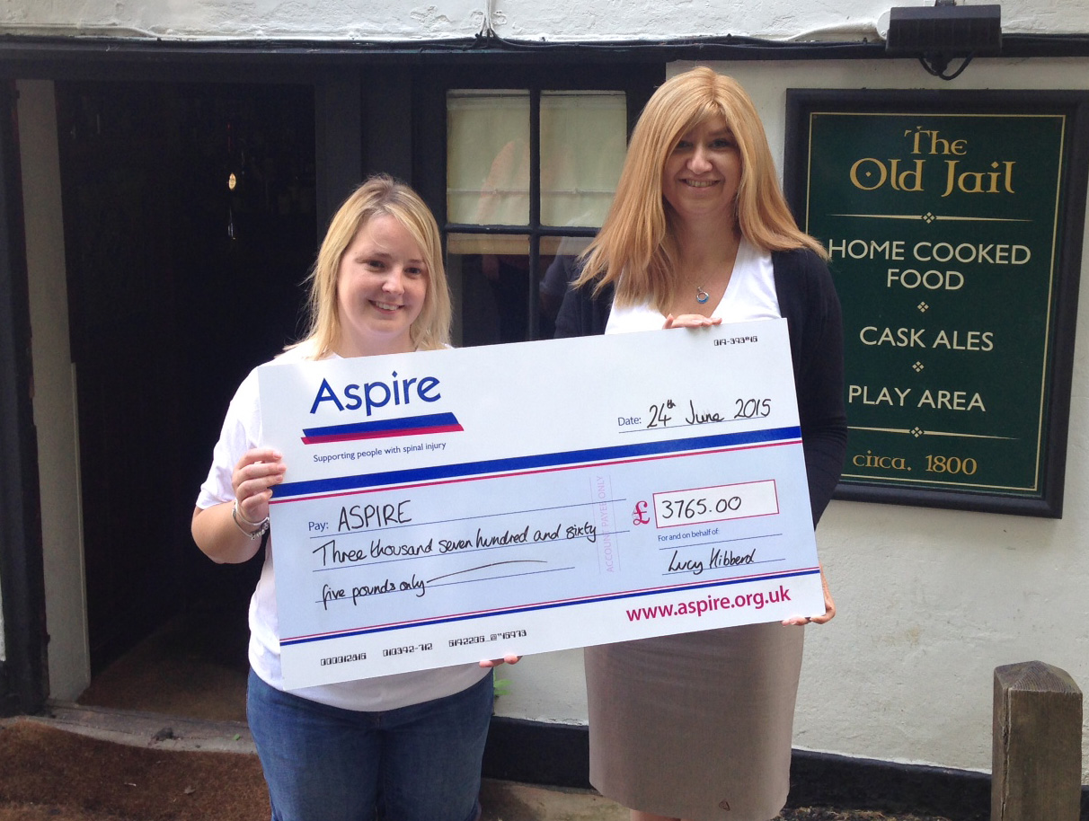 Lucy Hibberd presenting a cheque to Aspires Hannah Wyatt