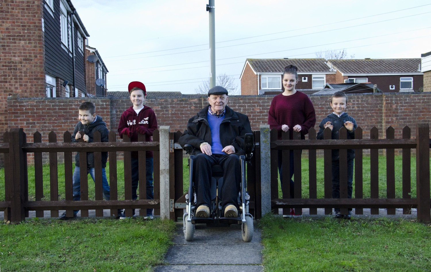 Richard in his wheelchair flanked by four of his grandchildren