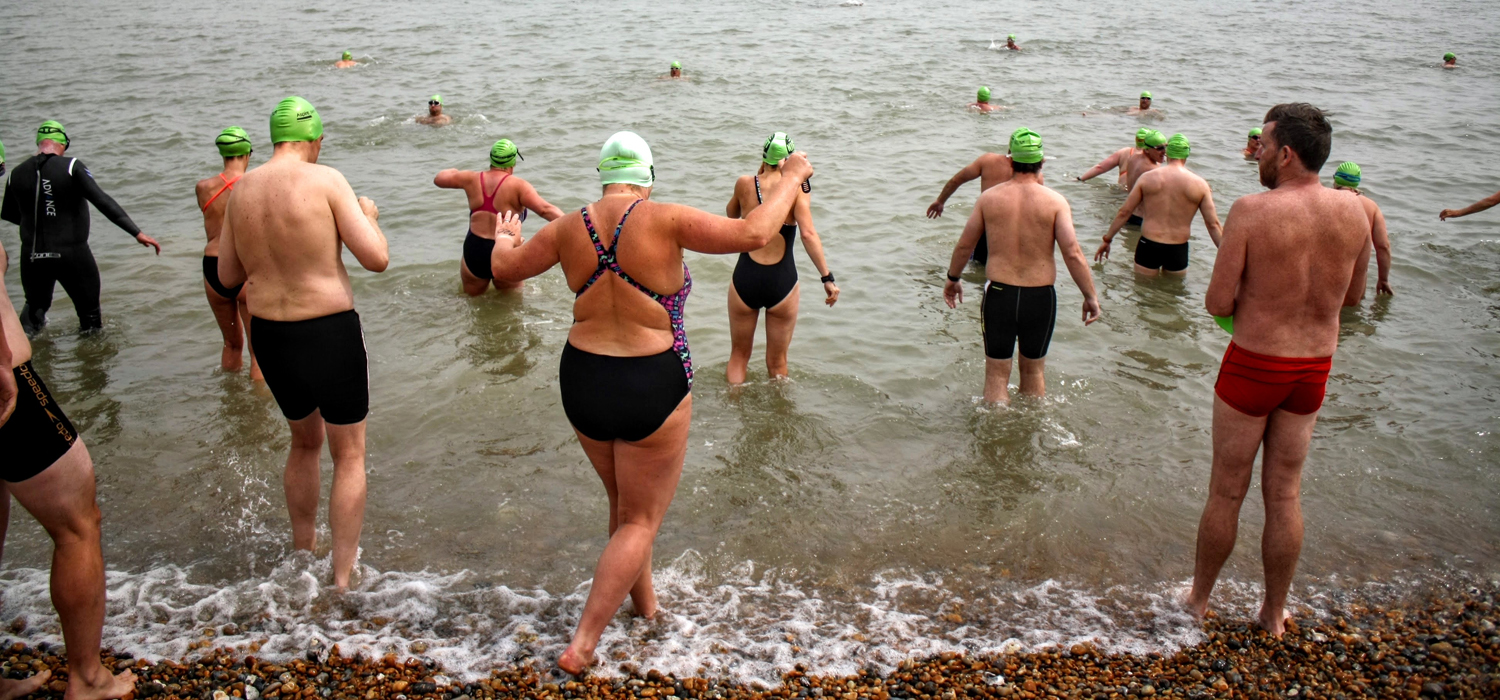 Swimmers at the edge of the water at Dover