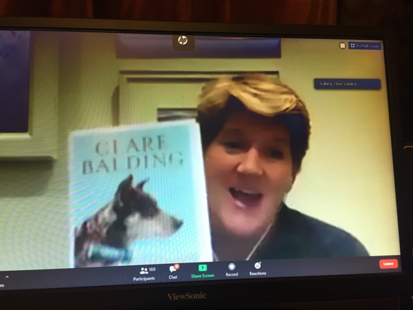 Clare Balding with her book on Zoom