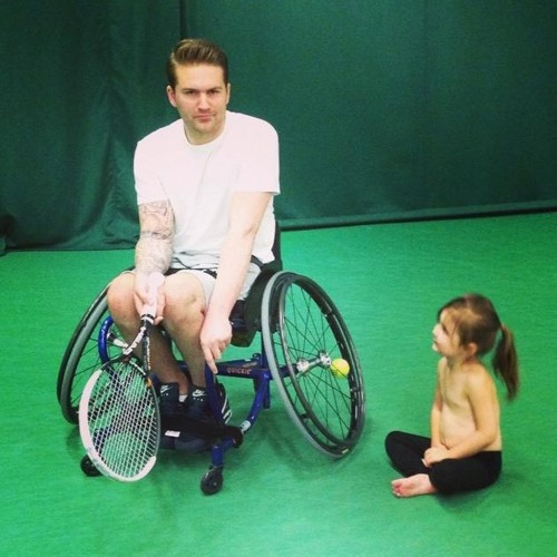 Ben in his wheelchair playing tennis