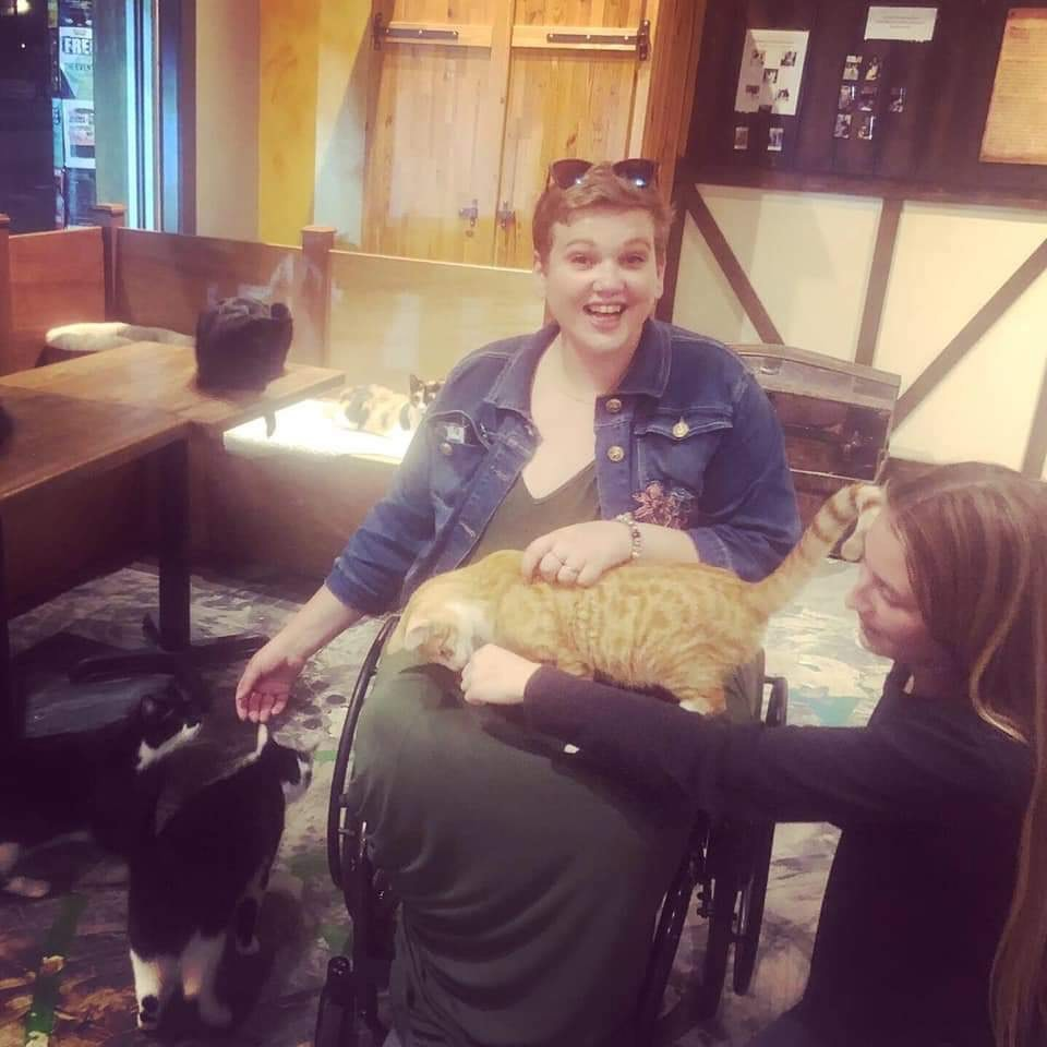 Georgina in her wheelchair with her cat