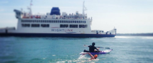 Solent swimmer and ferry