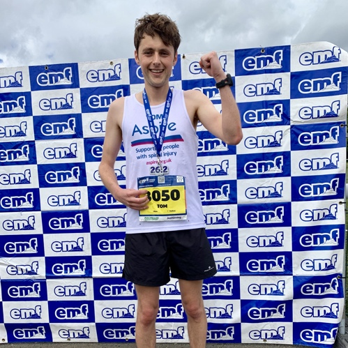 Tom with his medal for the Edinburgh Marathon