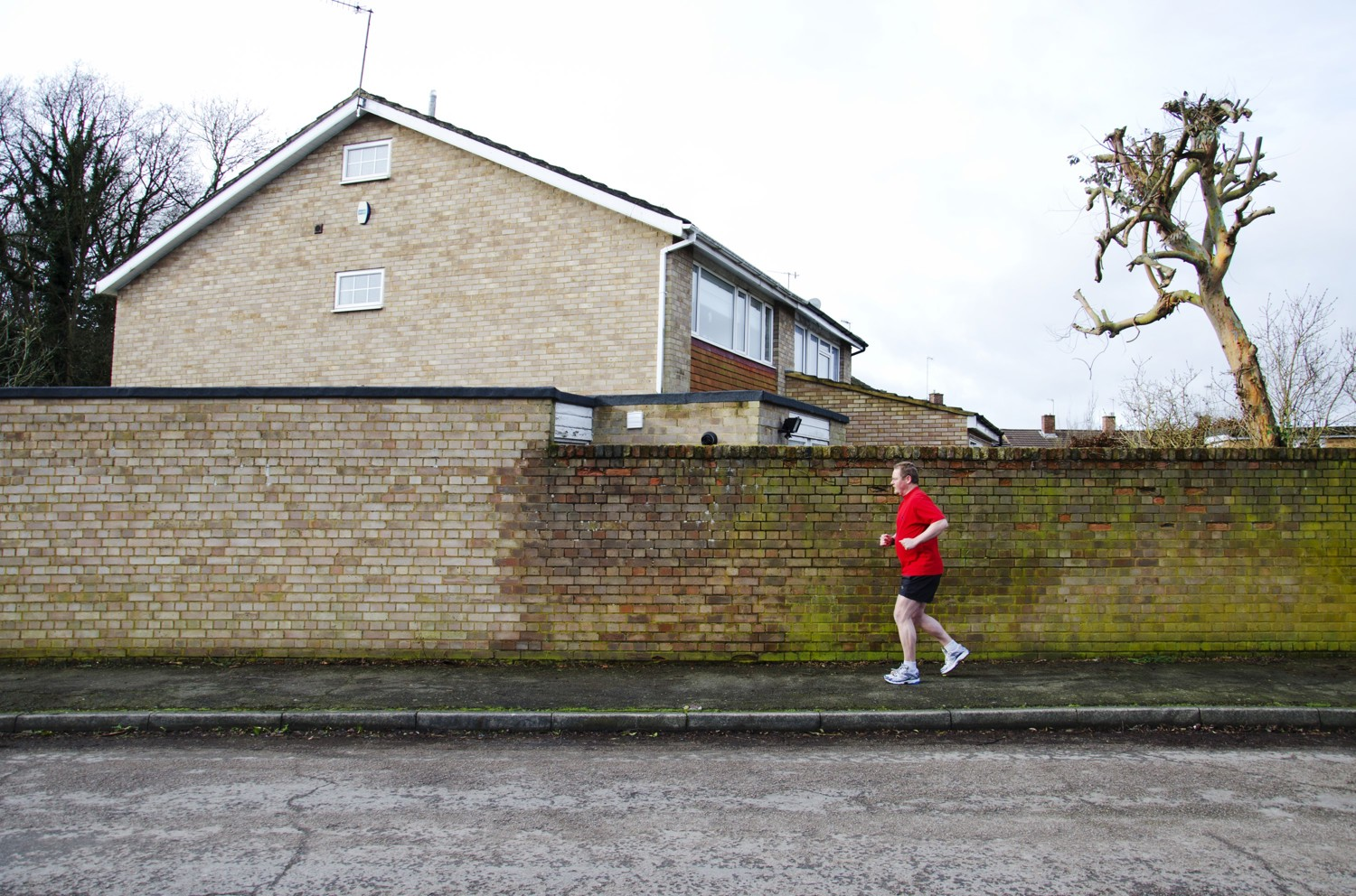 Andrew jogging by a wall