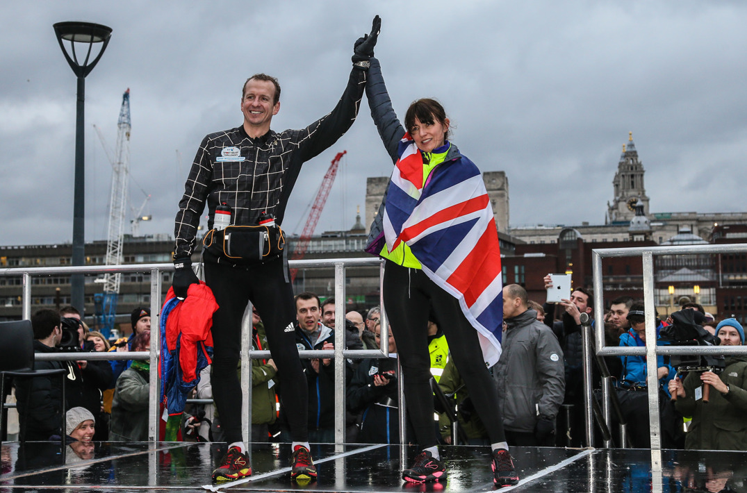 Greg Whyte celebrating with Davina McCall on a podium