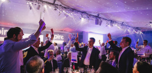 Sports Quiz Dinner attendees playing heads or tails