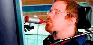 Neil using assistive technology