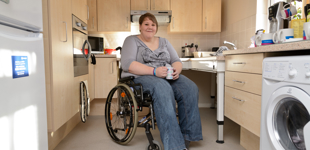 Wheelchair user Amy in an Aspire House