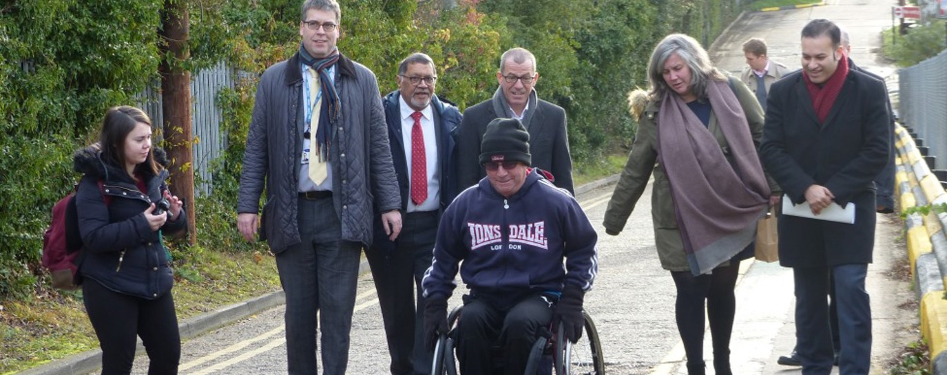 Wheelchair user Joe Gilbert and others at Stanmore station