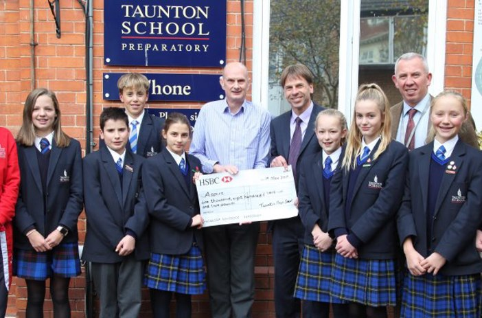Taunton School swimmers with cheque