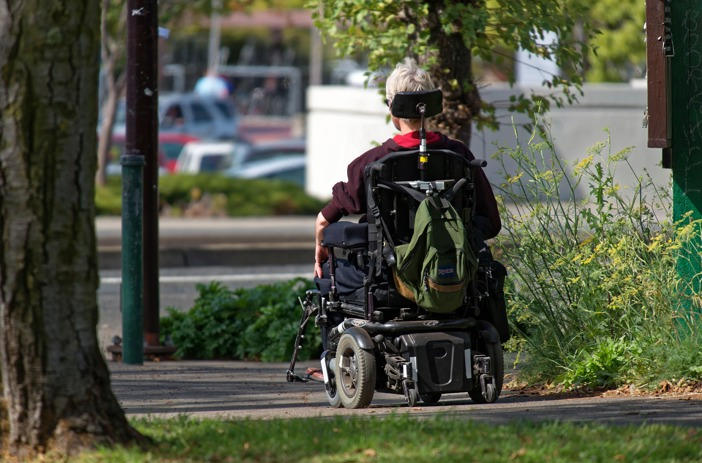 Motorized wheelchair user
