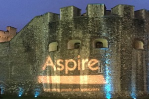 The Tower of London with the Aspire logo projected