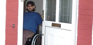 Disabled man in his doorway