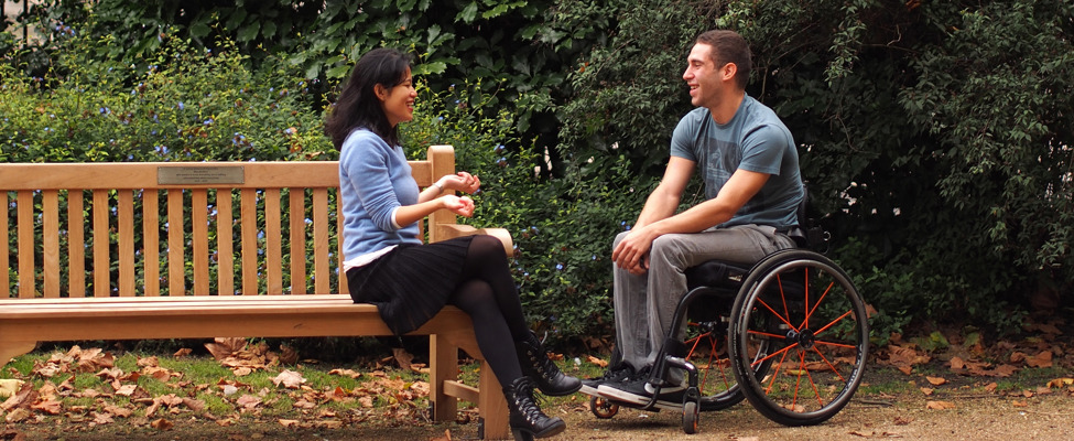 wheelchair user with friend in the park