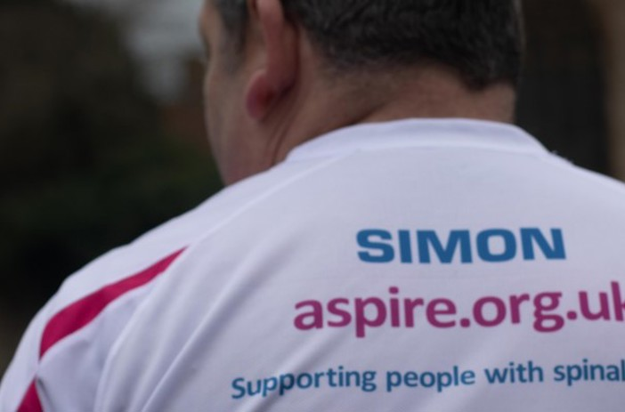 Back view of Simon with Aspire t-shirt