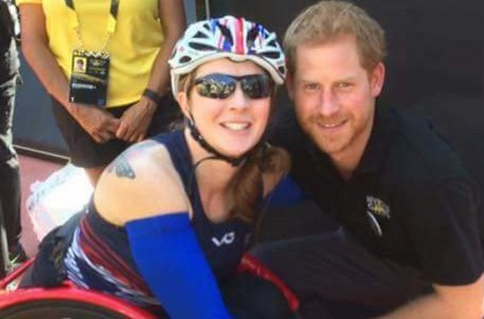 Lindsay in her racing wheelchair with Prince Harry