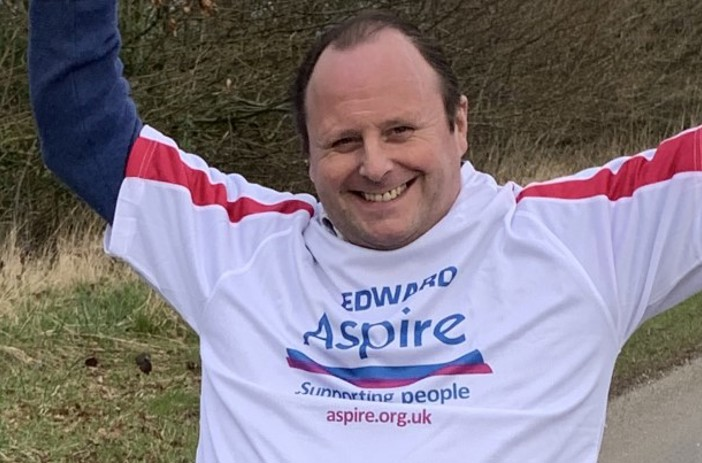Edward in his Aspire t-shirt in his wheelchair