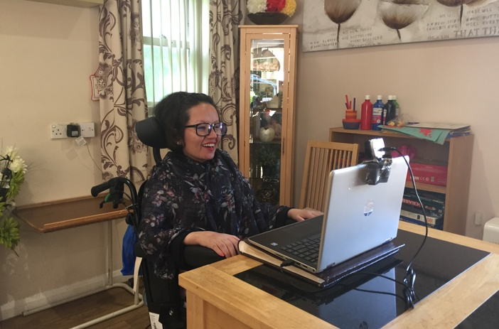 Sharooti using assistive technology with her laptop