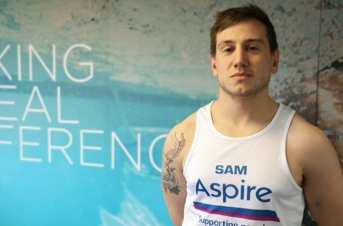 Sam in his Aspire running vest