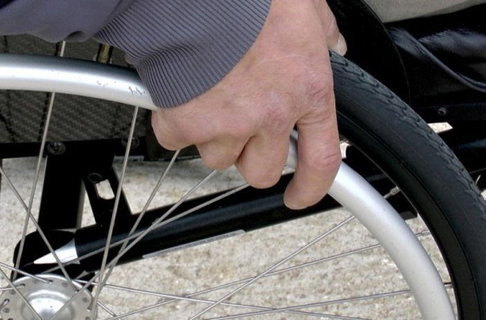 Hand on wheelchair