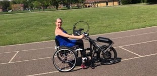 Lindsay handcycling on a track