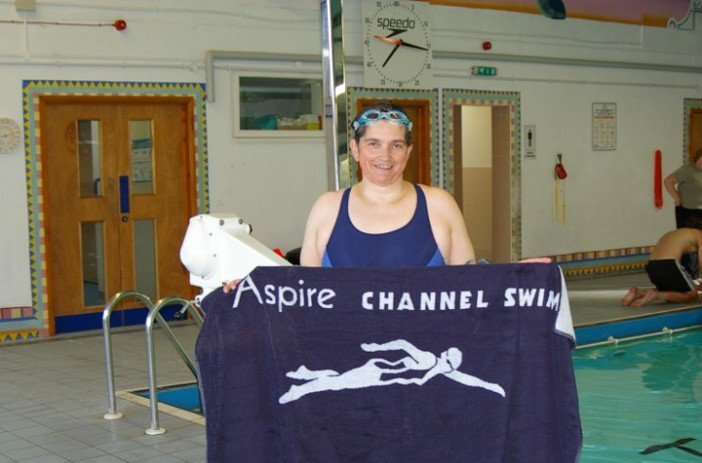 Eleanor by a pool with an Aspire Channel Swim towel